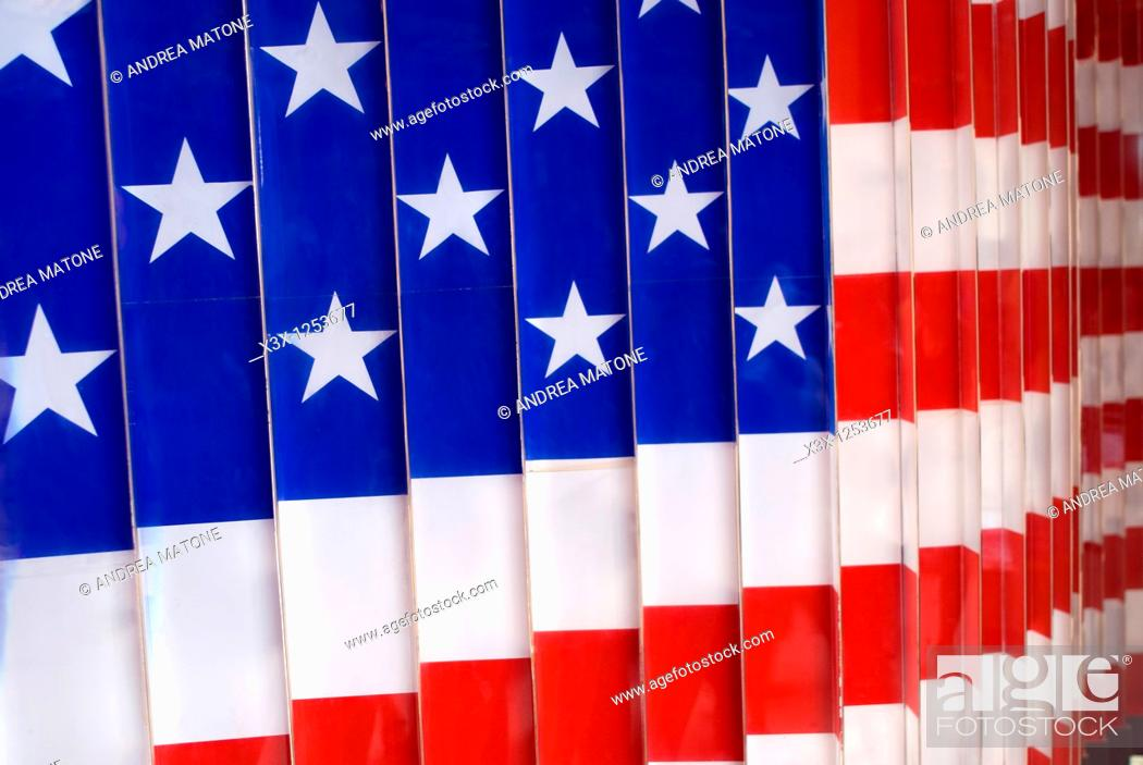 Stock Photo: The American Flag in the immigration museum of Ellis Island NYC USA.