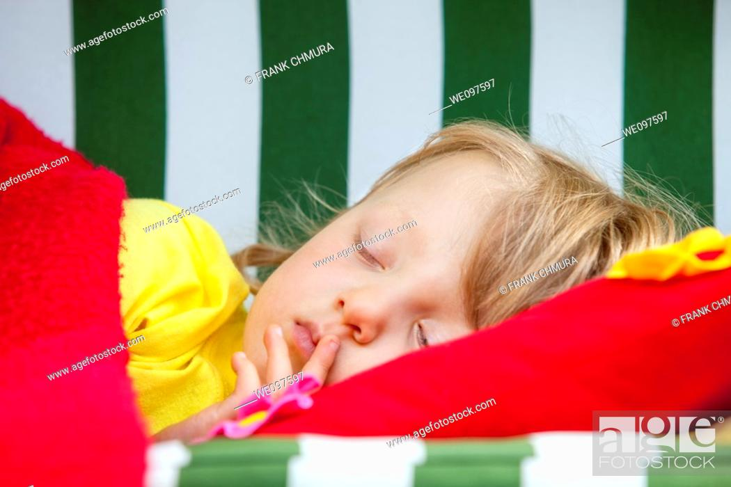 Stock Photo: boy with long blond hair sleeping.