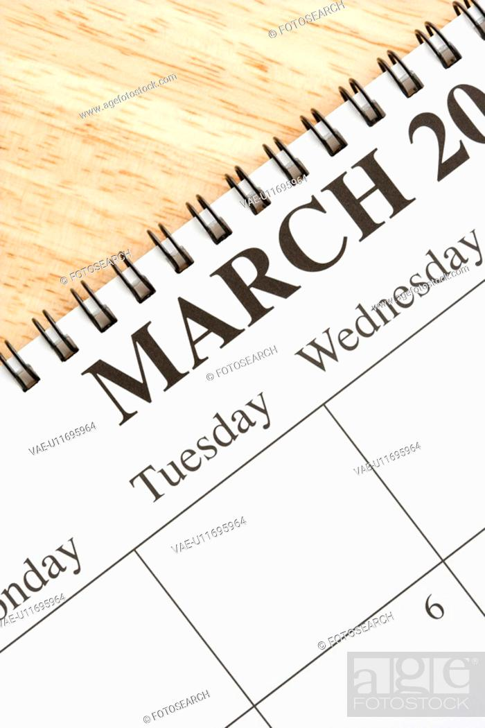 Stock Photo: Close up of spiral bound calendar displaying month of March.