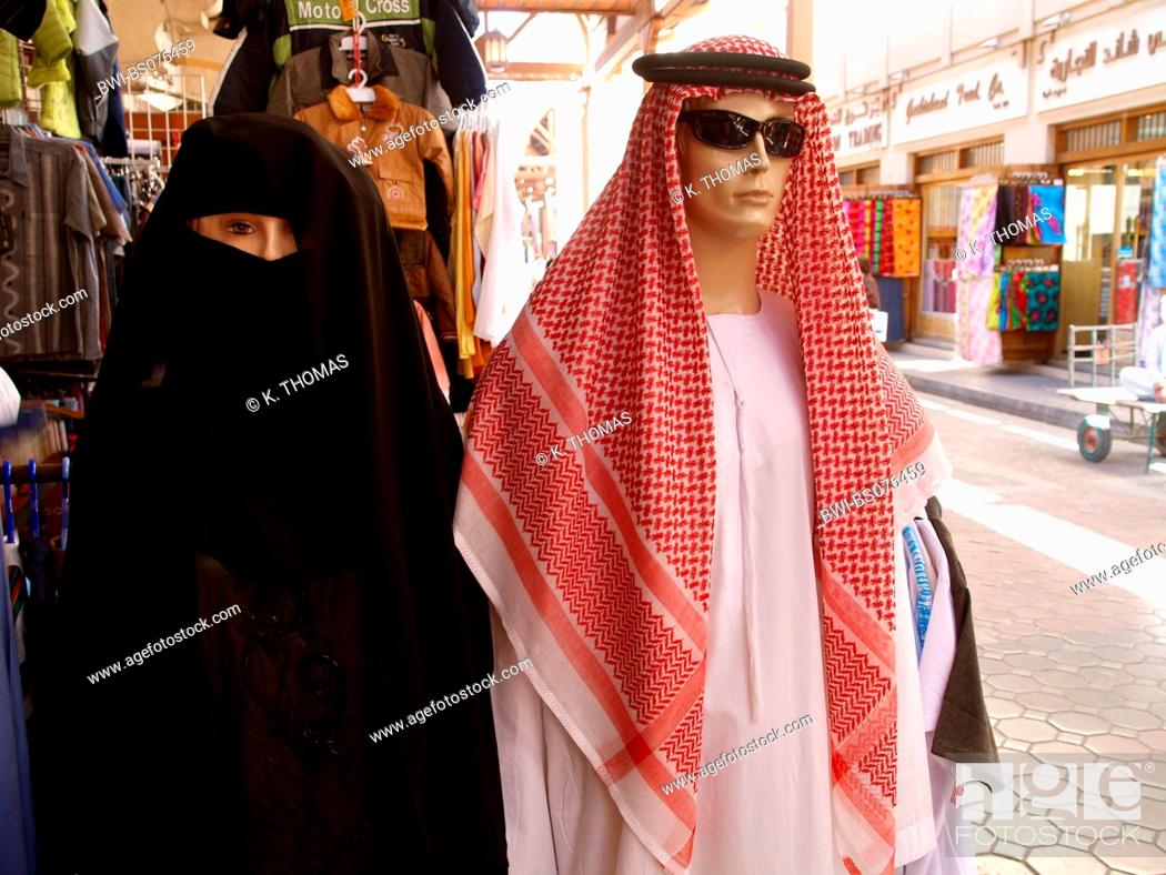 Dubai, manikins with sheik clothes and Muslim womens clothes, United
