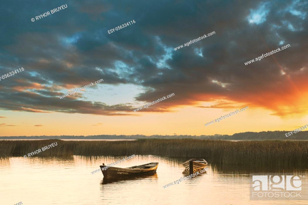 Stock Photo: Wooden Rowing Fishing Boats In Beautiful Summer Sunset On Lake. Nature Of Belarus.