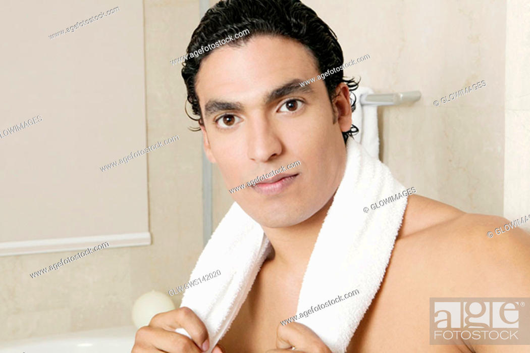 Stock Photo: Portrait of a young man in the bathroom.