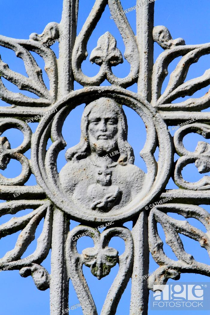 Stock Photo: Face of Jesus Christ on a gray metal cross against blue sky. Coulommiers. Seine et Marne. France. Europe.