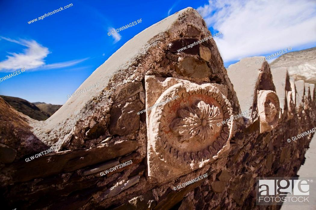 Stock Photo: Carvings on surrounding wall of a temple, Pantheon, Real De Catorce, San Luis Potosi, Mexico.