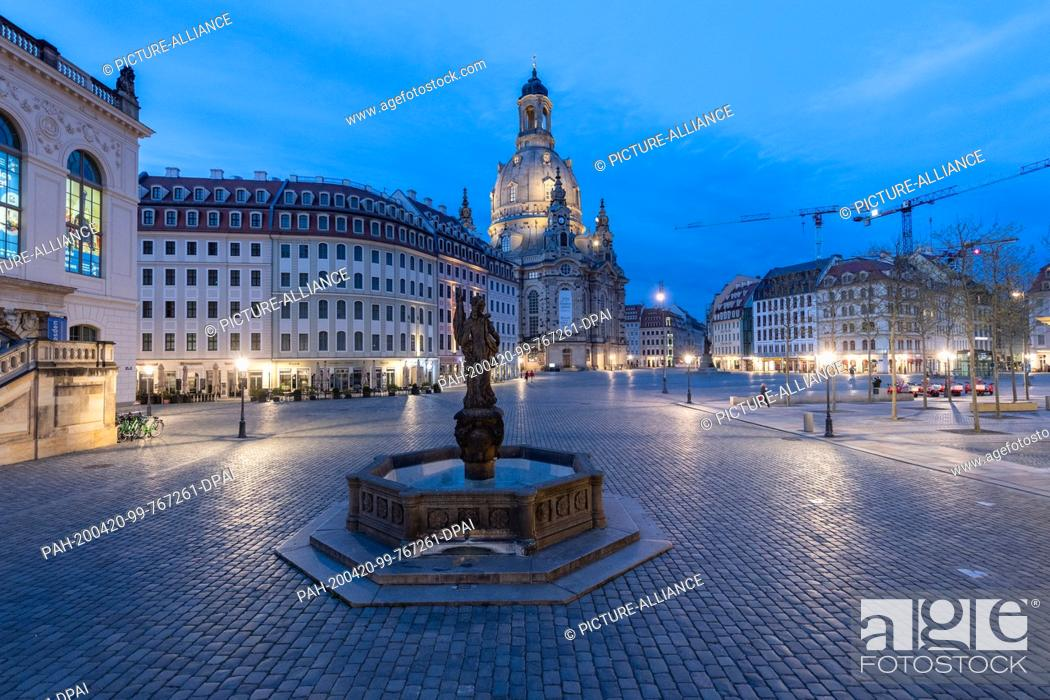 Stock Photo: 18 April 2020, Saxony, Dresden: The Neumarkt in front of the Frauenkirche (M), the Museum of Transport (l) and the Friedensbrunnen is deserted.