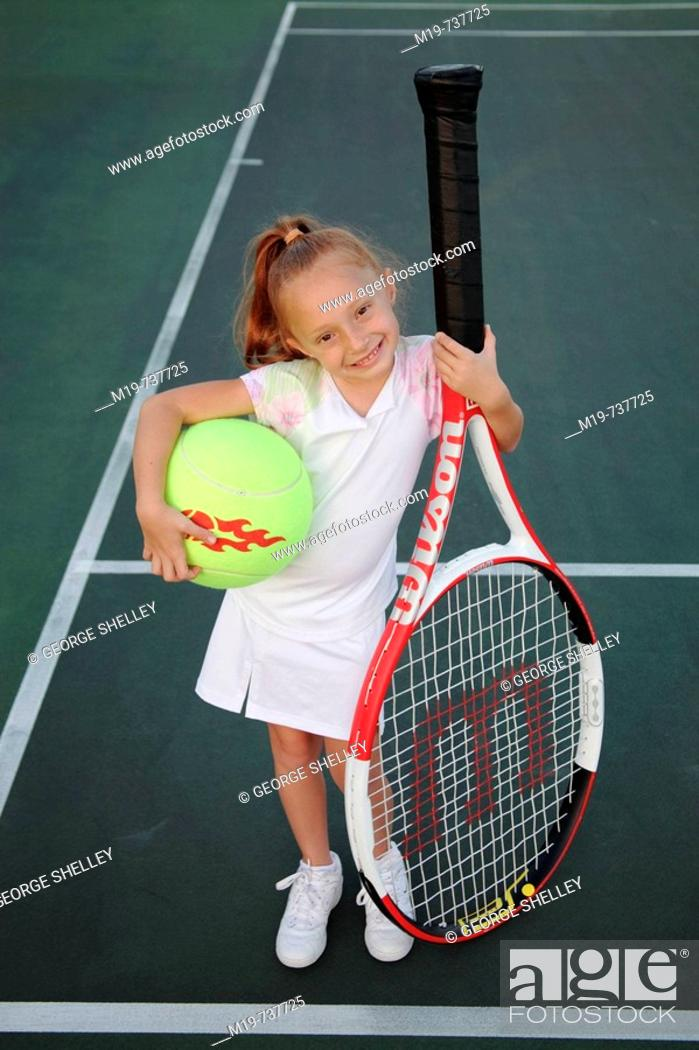 Stock Photo: Kid with an oversized tennis racket and ball.