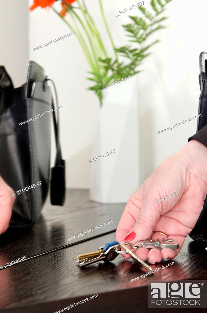 Stock Photo: Woman's hand with keyring.