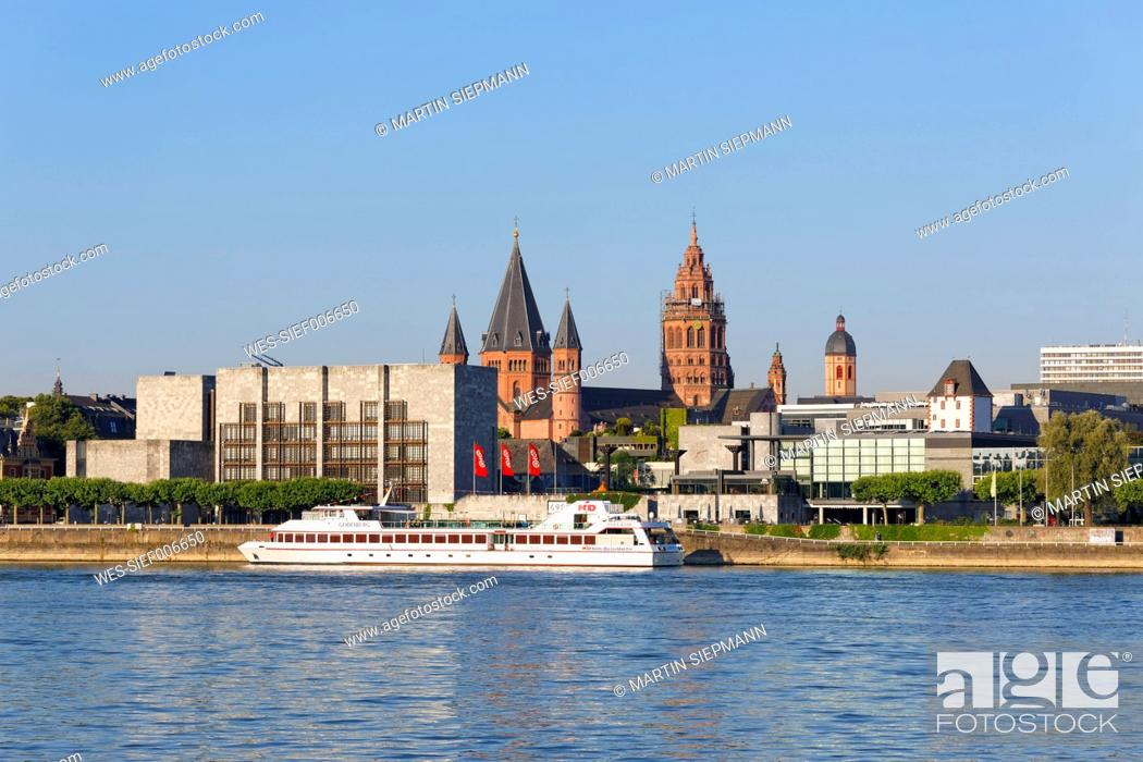 Stock Photo: Germany, Mainz, view to town hall and Rheingold Hall with Rhine River in the foreground.