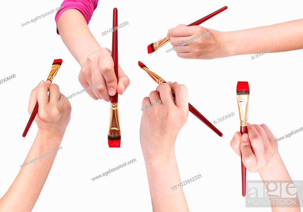 Photo de stock: set of hands with art paintbrushes with red tips.