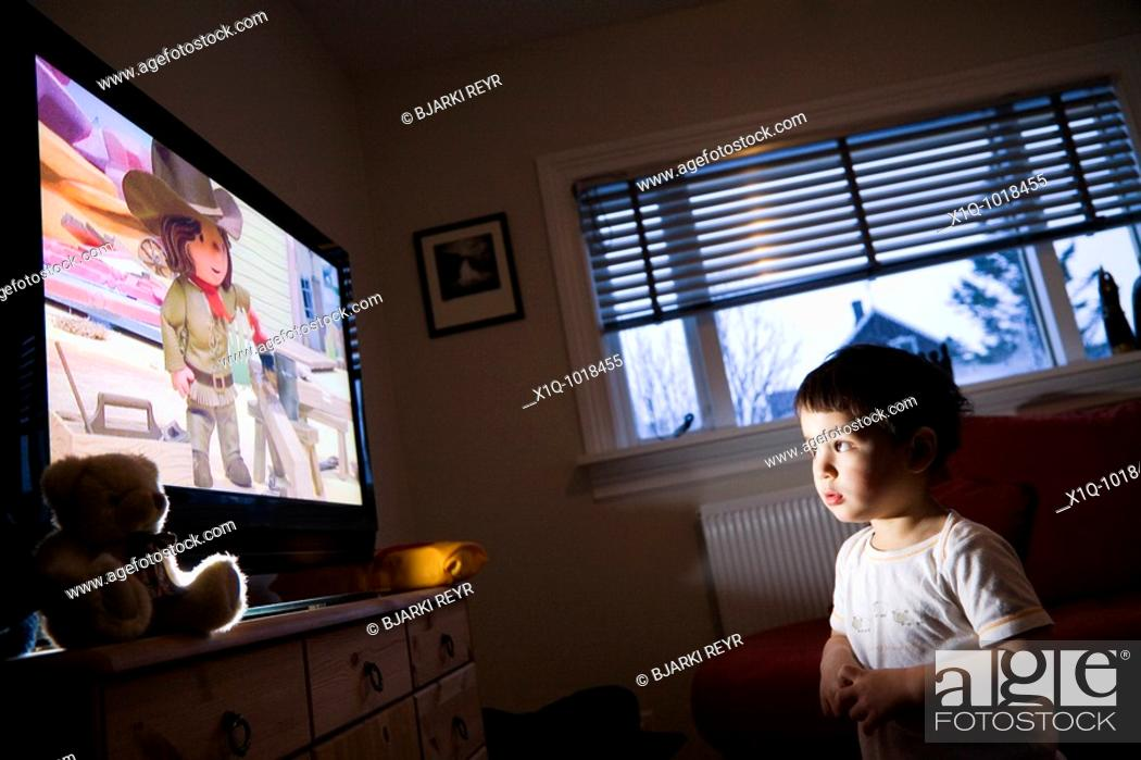 Stock Photo: Young boy watching Bob the Builder on television at home  Iceland.