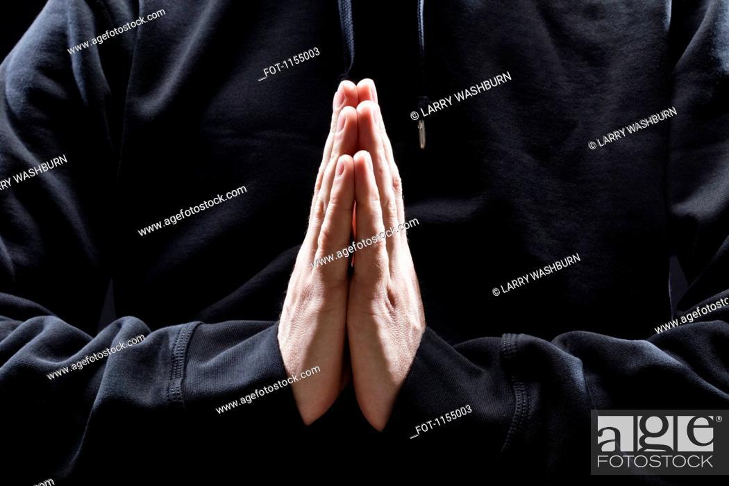 Stock Photo: Man with prayer hands.