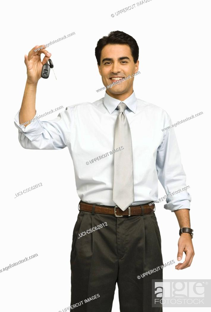 Stock Photo: Businessman holding car keys.