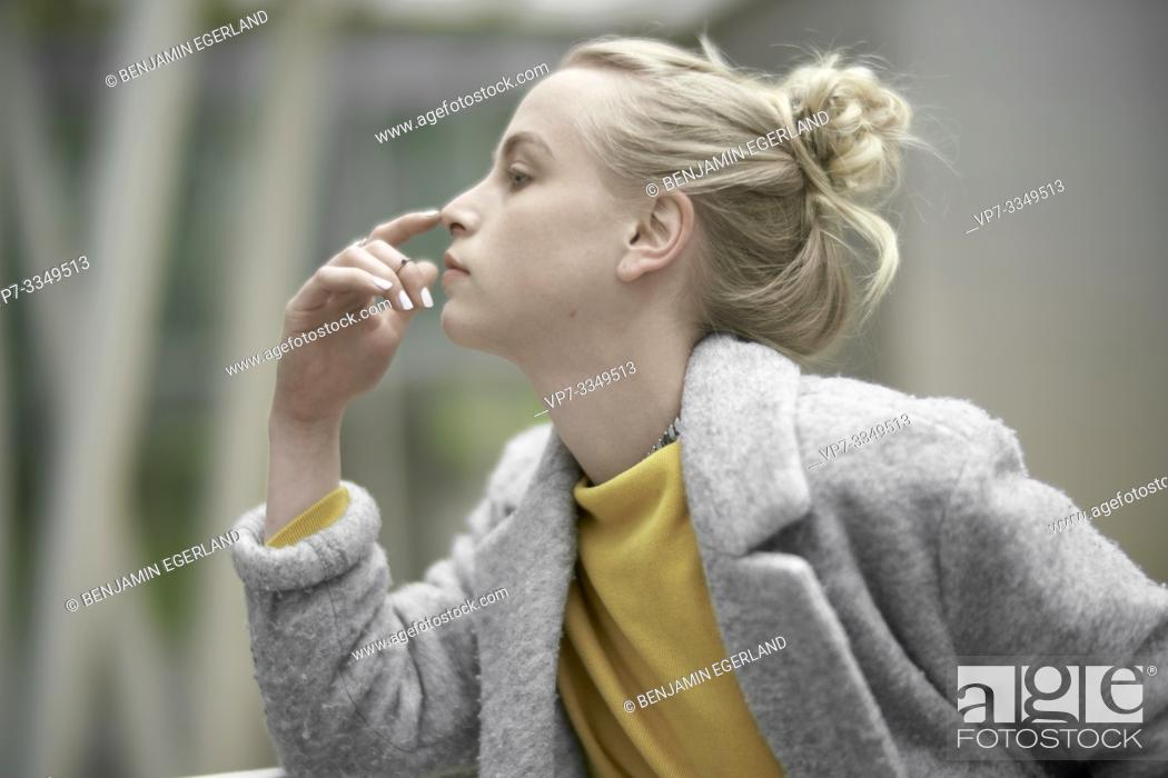 Stock Photo: side view of young contemplative woman.