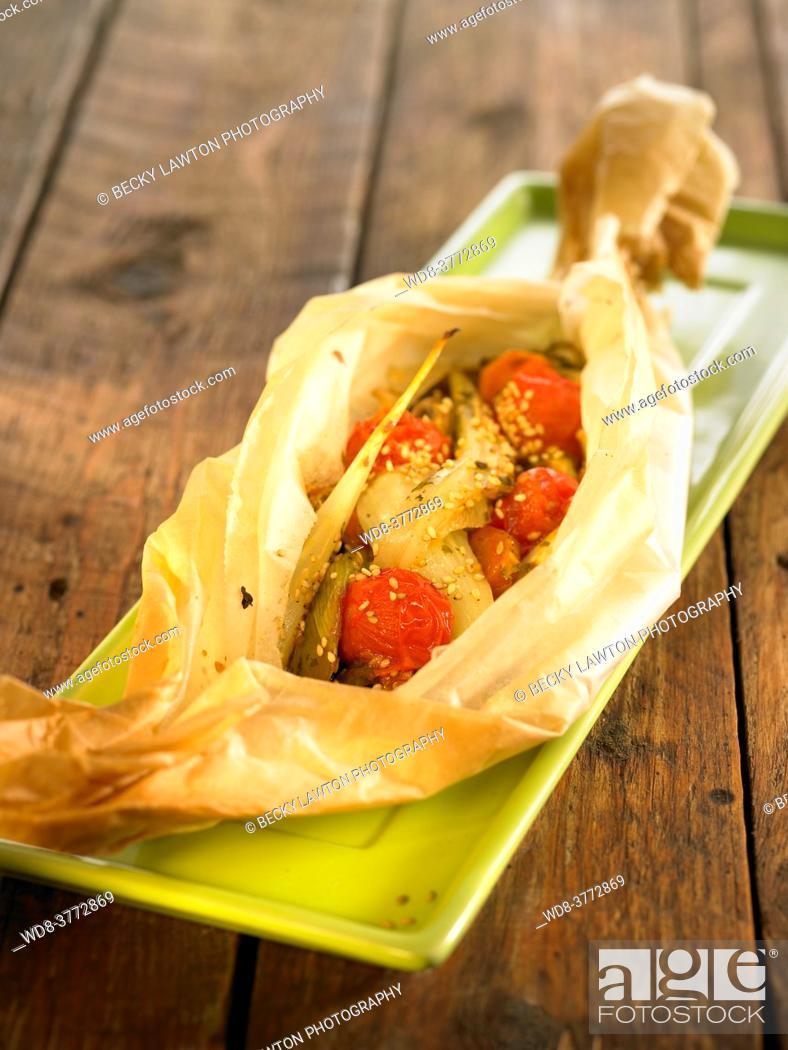 Stock Photo: papillote of vegetables and mushrooms.