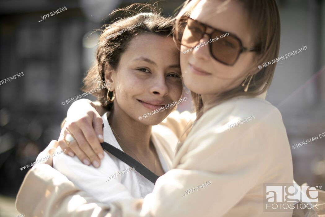 Stock Photo: two stylish fashion blogger friends embracing.