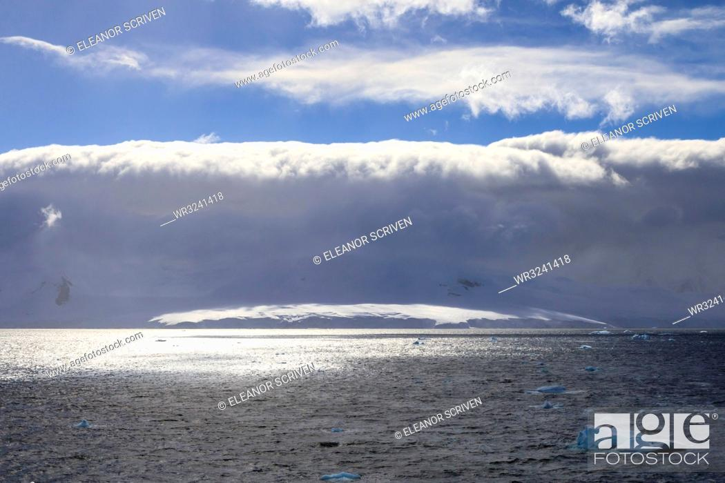 Stock Photo: Arcus cloud over the mountains of the Gerlache Strait, blue sky, Antarctic Peninsula, Antarctica, Polar Regions.