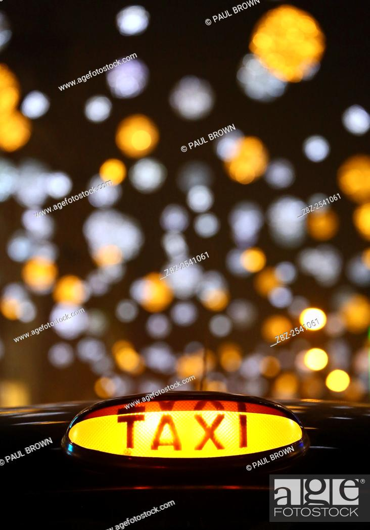 Stock Photo: Black London taxi cab at the switching on of Oxford Street Christmas lights and Xmas decorations in London but some failed to switch on immediately and only.
