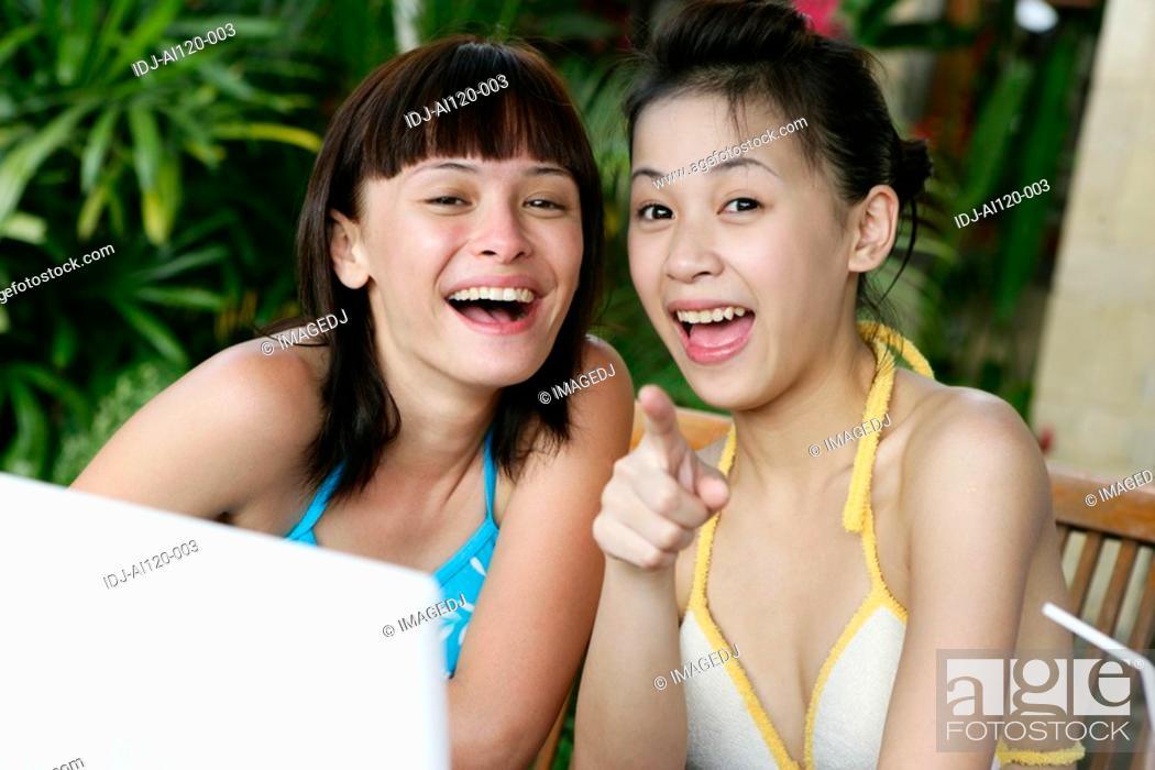 Stock Photo: Portrait of two teenage girls smiling.