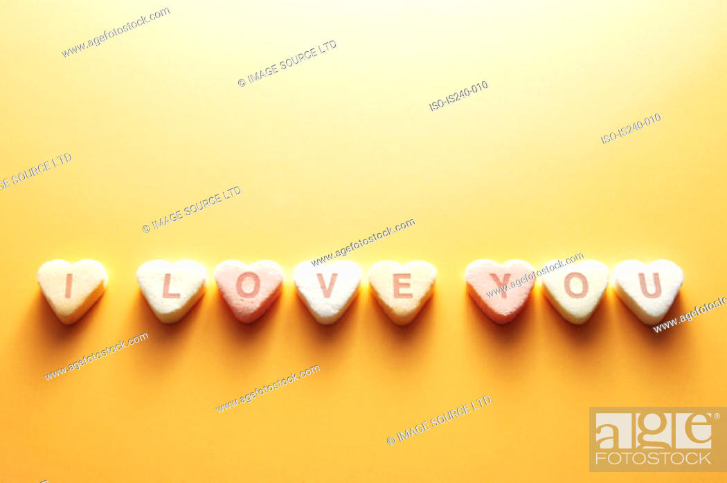 Stock Photo: Message on heart shaped sweets.
