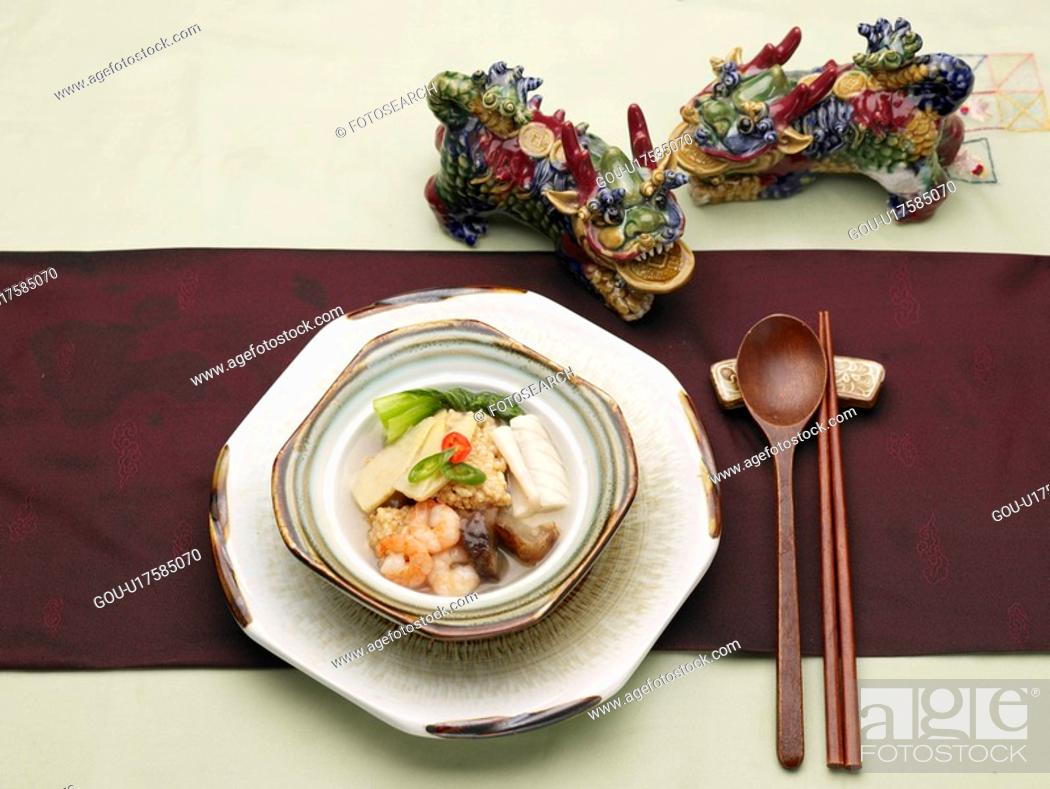 Stock Photo: table mat, spoon, decoration, food styling, chopsticks, sizzling rice soup.