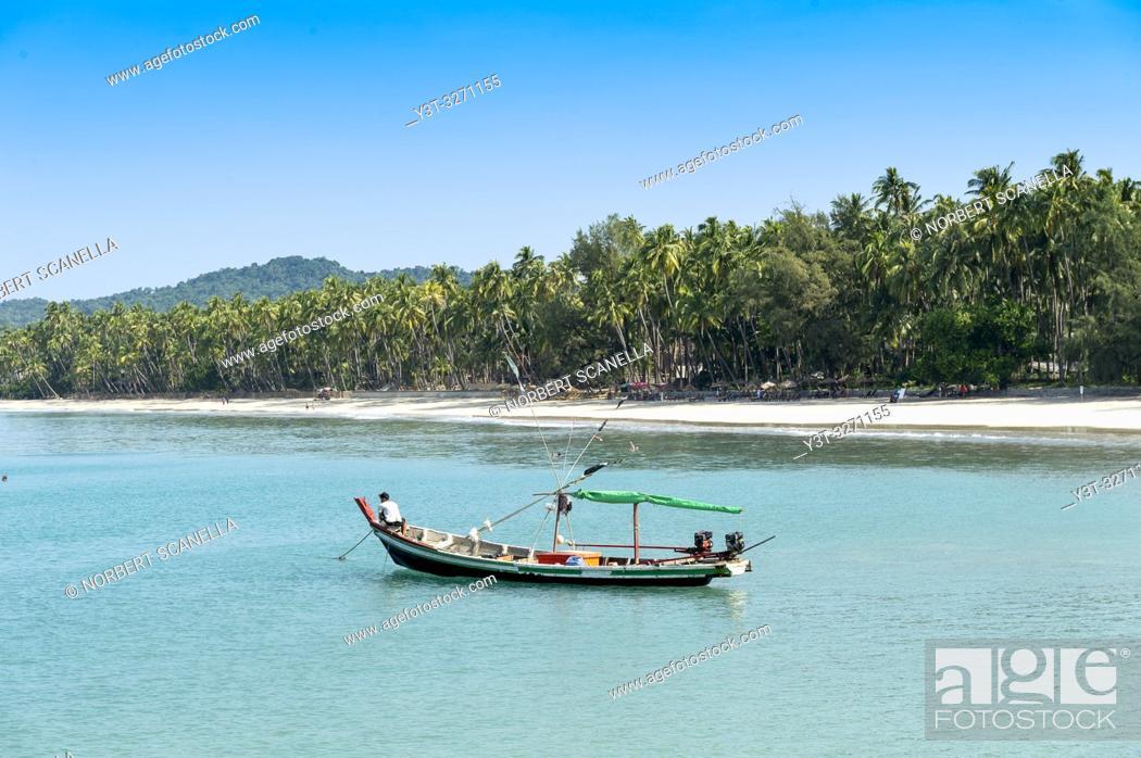 Stock Photo: Myanmar (ex Birmanie). Ngapali. Arakan state. Bengal Golf Course. Fisherman village. Fisher boat at the bay.