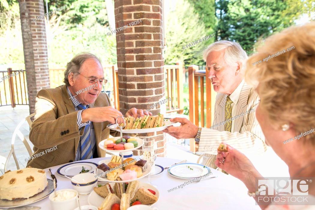 Stock Photo: Senior people having tea on the balcony.