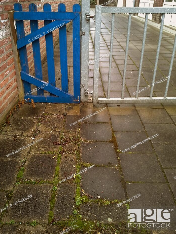 Stock Photo: blue gate to driveway.