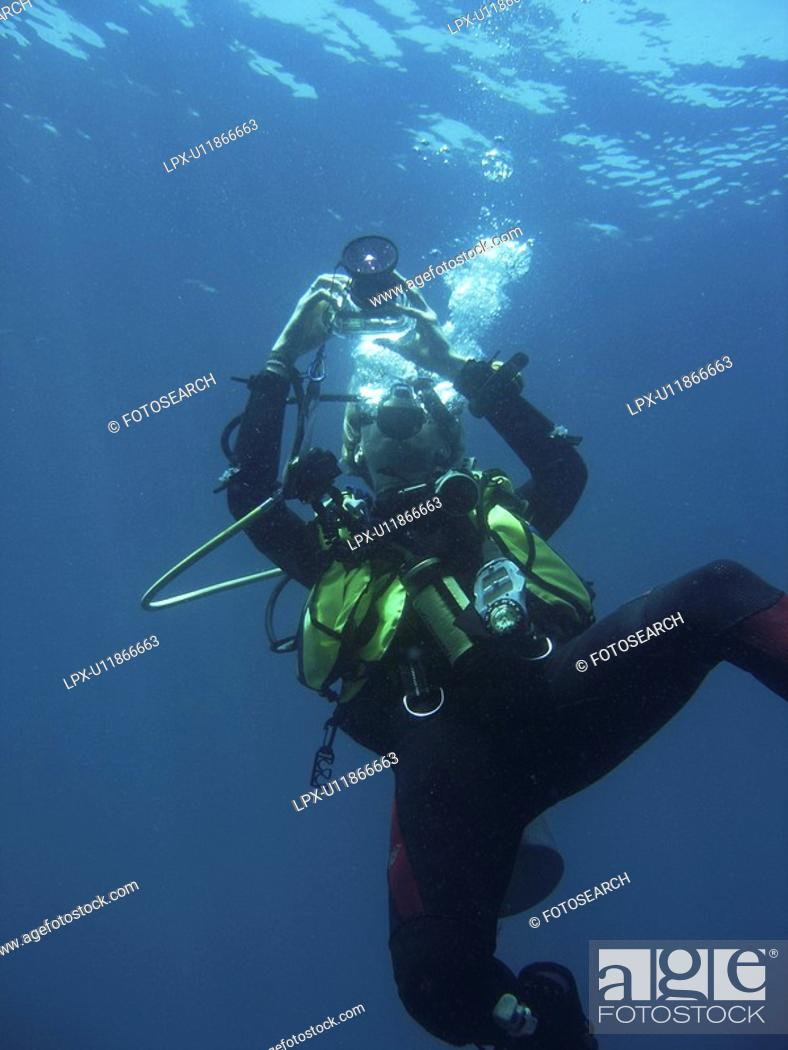 Stock Photo: Diver taking a photo. Sabang . Philippines. Taken 2007.