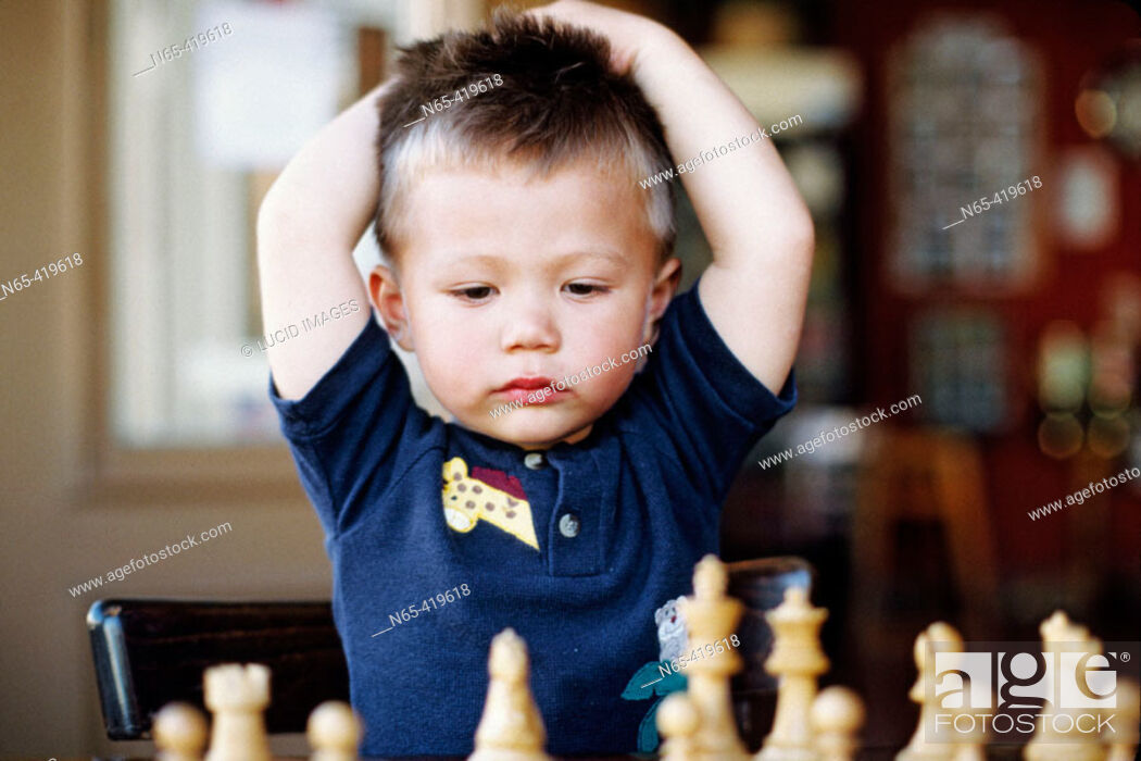 Stock Photo: Young boy playing chess.