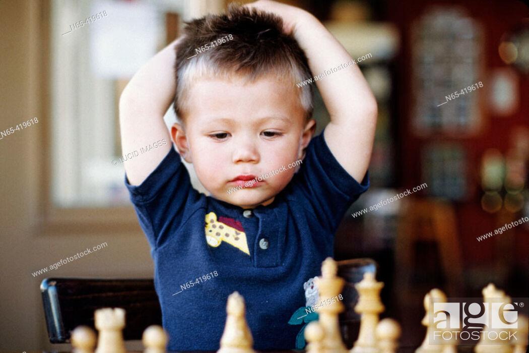 Photo de stock: Young boy playing chess.