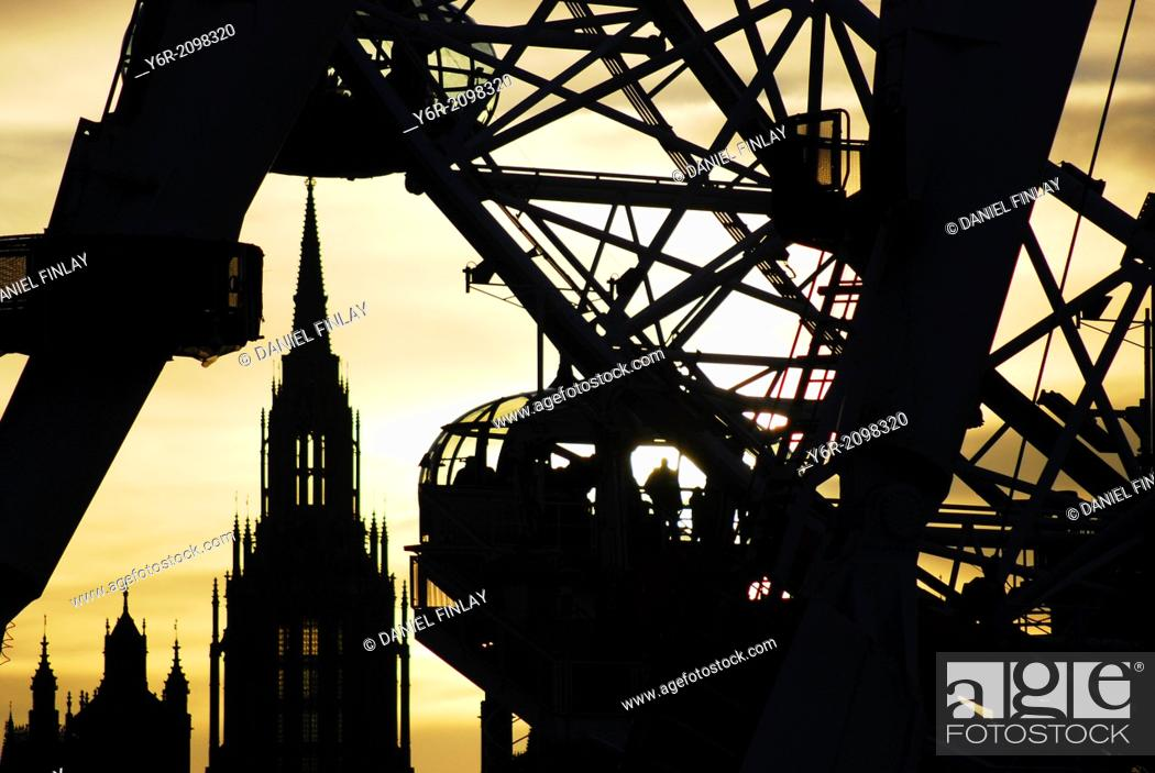 Stock Photo: The London Eye seen against a sunset, in the heart of London, England, on a Winters evening.