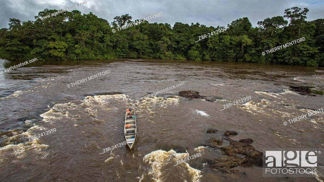 Stock Photo: Approuague river. Saut Athanase. Amerindian pirogue keeper in the rapids. French Guiana.