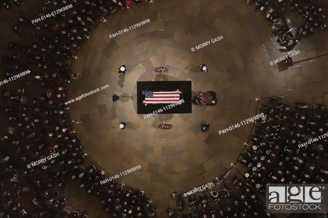 Stock Photo: Vice President Mike Pence and wife Karen help lay a wreath as Former President George H. W. Bush lies in state in the U.S. Capitol Rotunda Monday, Dec.