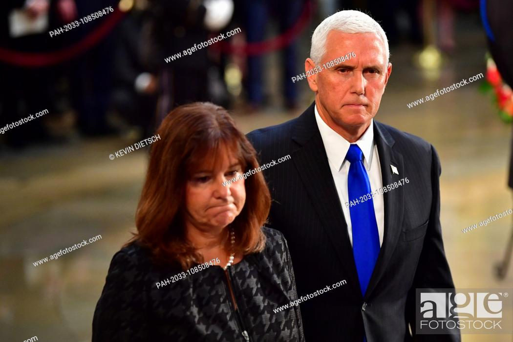 Stock Photo: Vice President of the United States Mike Pence and wife Karen Pence view the casket of former Senator John McCain in the Capitol Rotunda where he will lie in.
