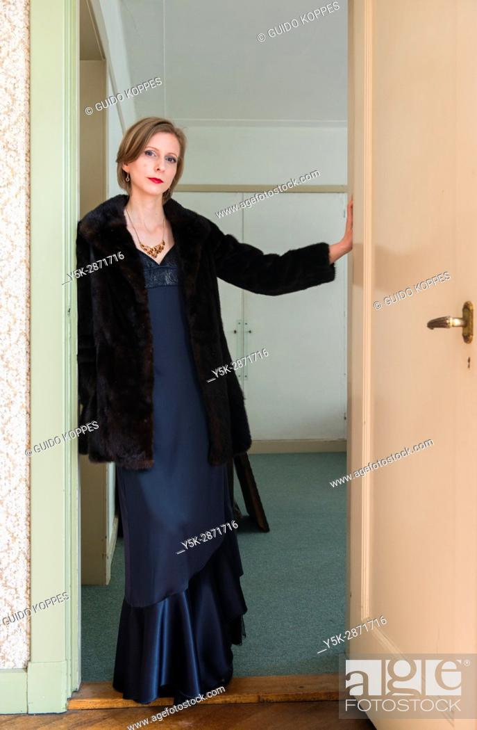 Photo de stock: Tilburg, Nederland, Adult caucasian woman wearing evening dress getting ready to go out to a classical concert.