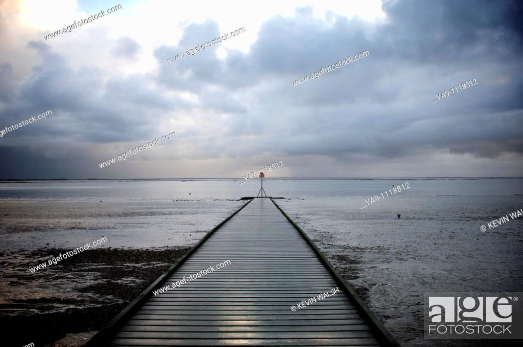 Stock Photo: Jetty and storm clouds.