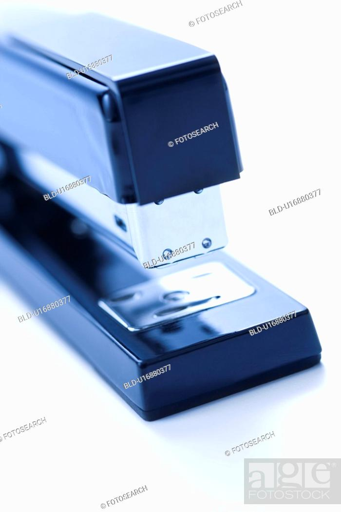 Stock Photo: Blue stapler on white background.