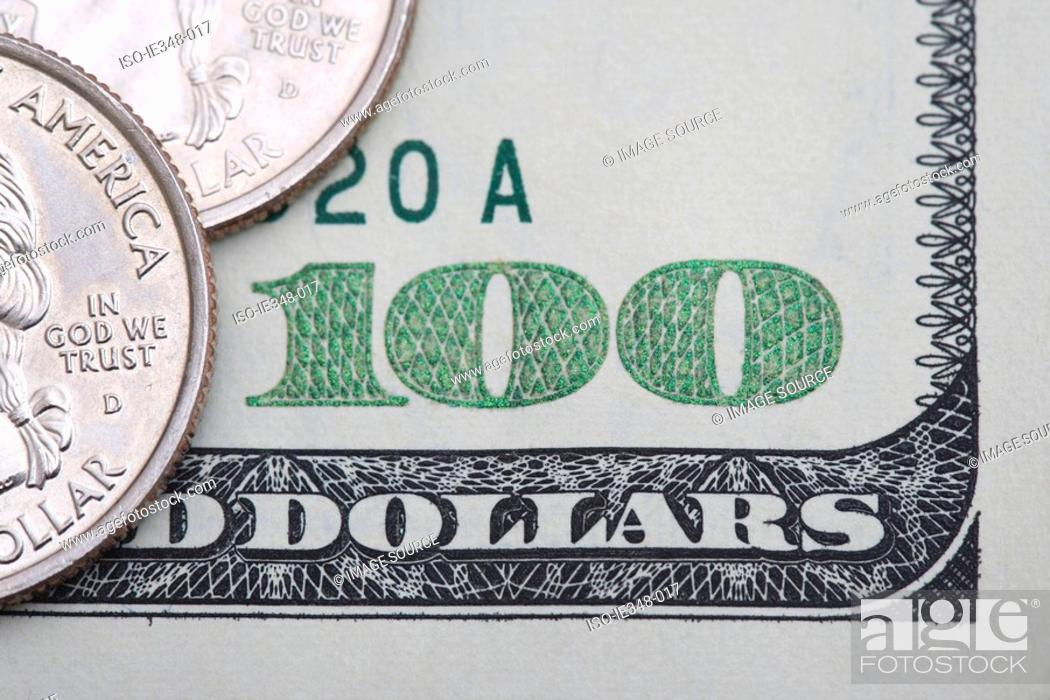 Stock Photo: Quarters on one hundred dollar bill.