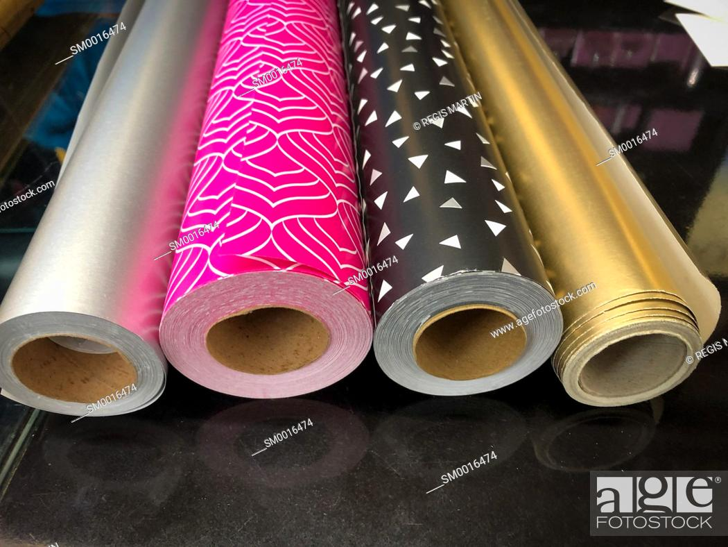 Stock Photo: Rolls of wrapping paper on a counter.