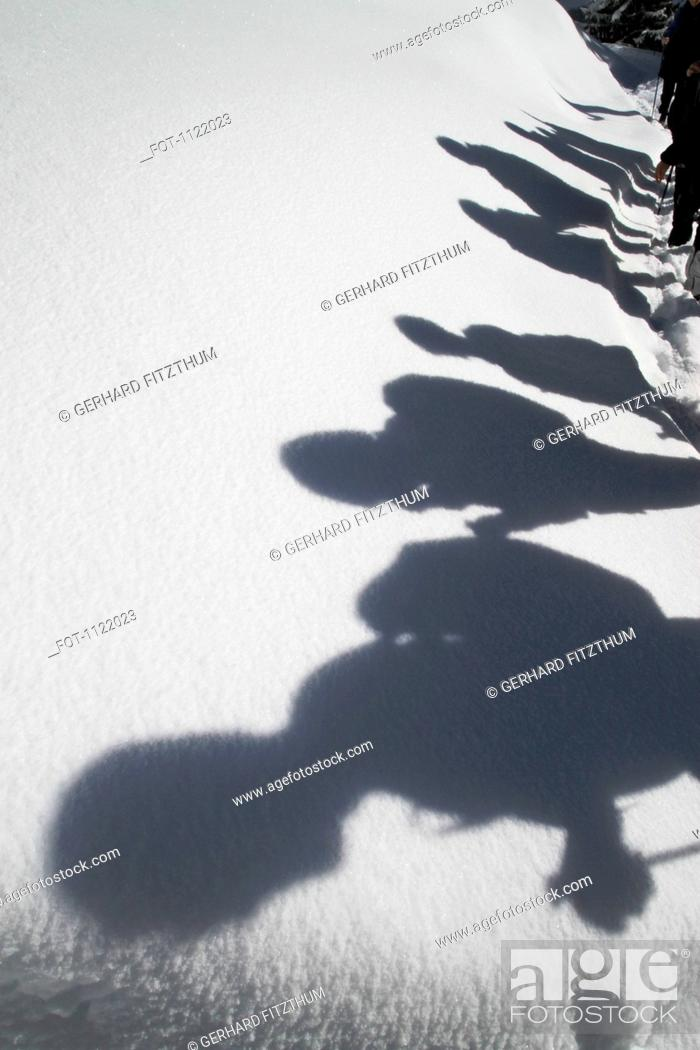 Stock Photo: Shadows of hikers against a blanket of snow.