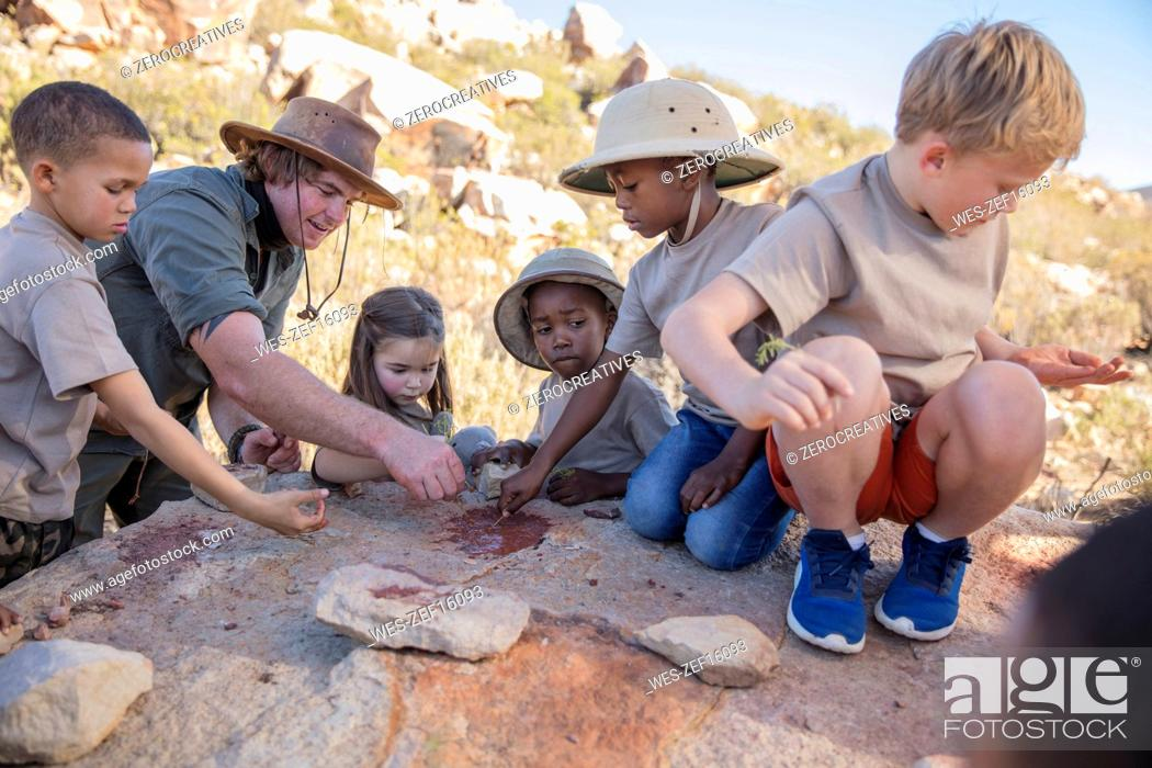 Stock Photo: Children at a camp learning from guide.