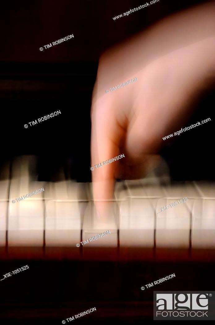 Stock Photo: Finger playing piano key.