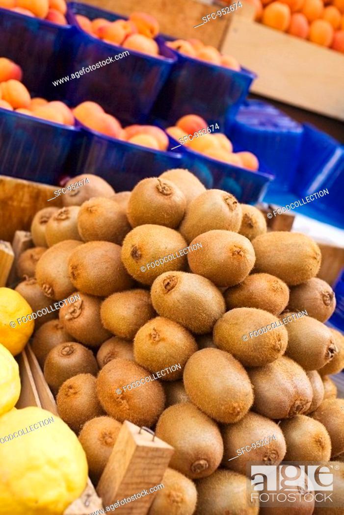 Stock Photo: Kiwi fruits, lemons and apricots at a market.
