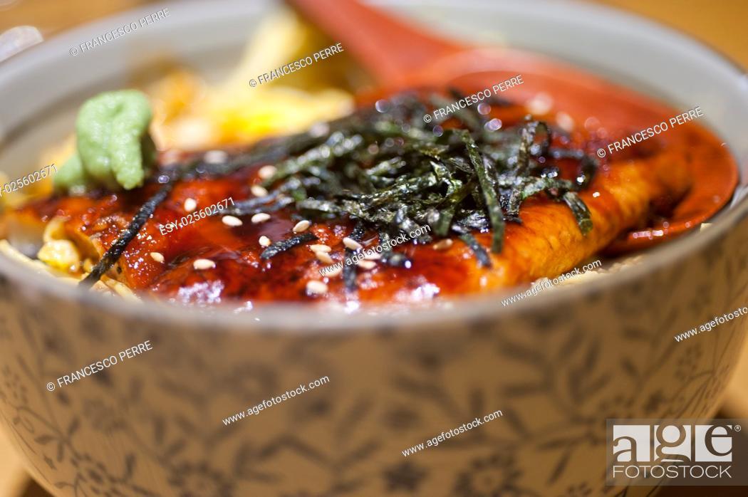 Stock Photo: traditional Japanese ramen noodles with unagi eel on top.