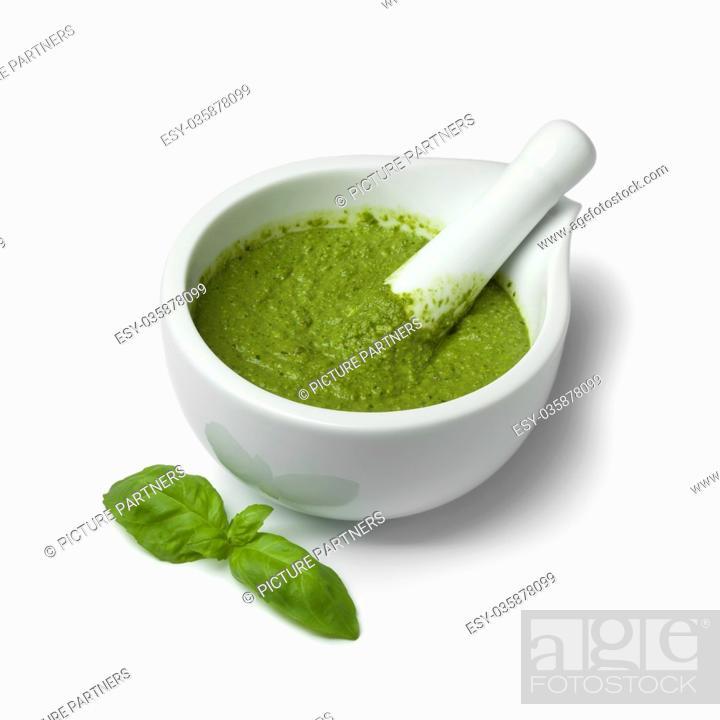 Photo de stock: Green homemade Italian pesto in a mortar on white background.