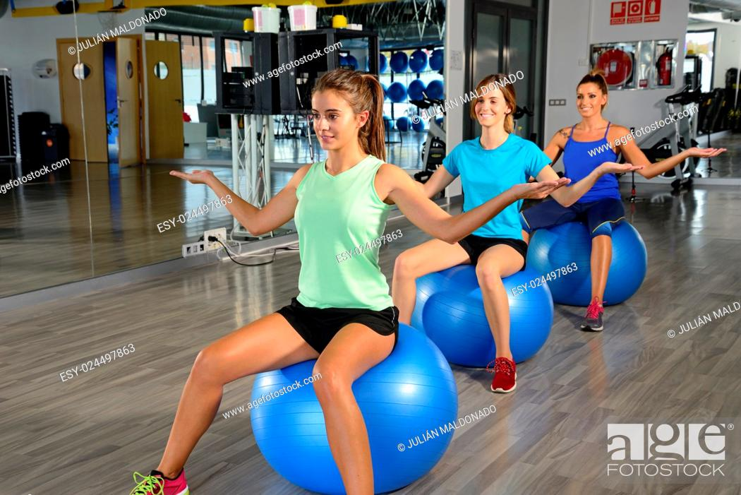 Stock Photo: Young women exercising in a gym.