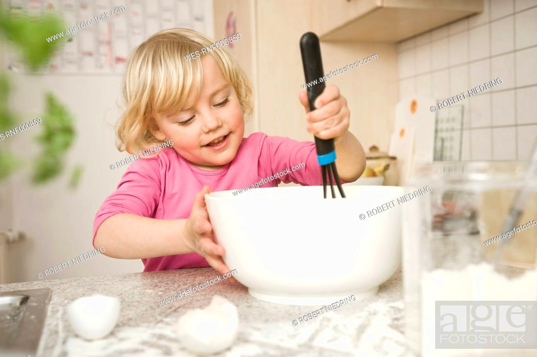 Stock Photo: Girl mixing ingredients in bowl.