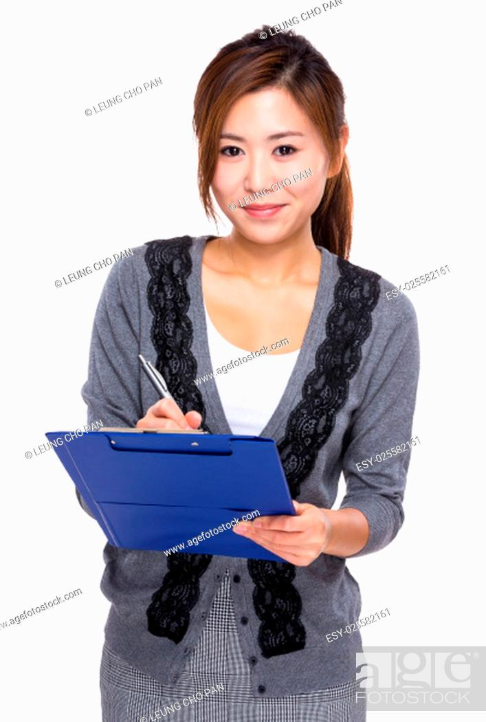 Stock Photo: Asian Woman write on clipboard.