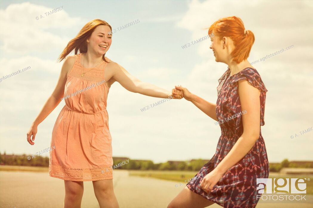 Stock Photo: Two young women having fun together.