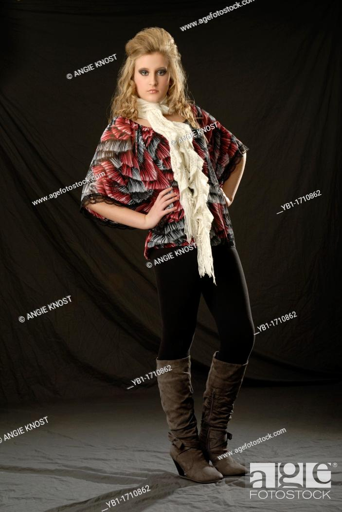 Stock Photo: Fashionable woman wearing stylish outfit accessorized with boots and scarf.